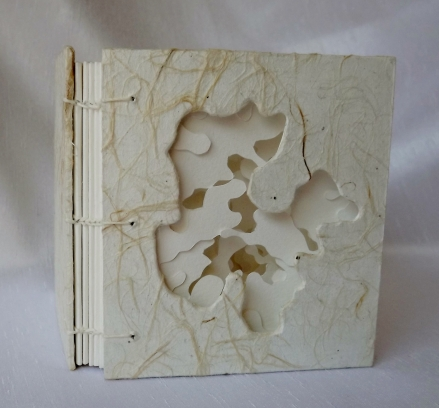 It's a Whiteout Coptic Stitched Artist's Book, Various Papers.
